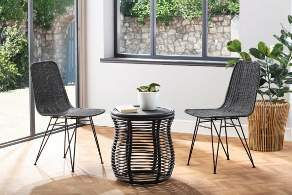 2 black porto dining chairs and royal lamp table lifestyle