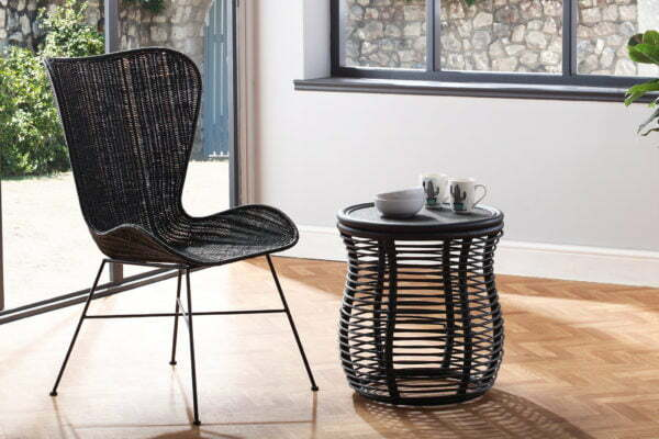 black porto wing chair and royal lamp table lifestyle