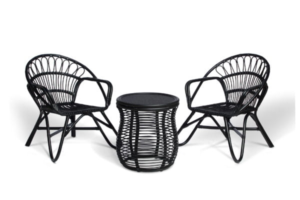 2 black nordic chairs and royal lamp table